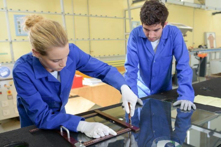 young metallurgists at work in school workshop