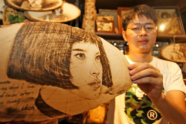 27-year-old Chinese man Peng Fang displays an art work of pyrography at his shop in Xi'an city, northwest China's Shaanxi province, 23 July 2018. Pyrography, which means writing or painting with fire, is the art of decorating wood or other materials with burn marks resulting from the controlled application of a heated object such as a poker. Peng Fang, a post-90s man, has loved pyrography for a long time. He is dedicated to improving and promoting pyrography, opening a pyrography art shop in Xi'an city, northwest China's Shaanxi province.