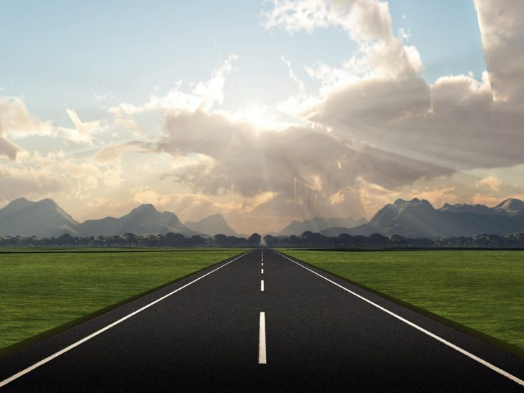 3D perspective of an open road.
