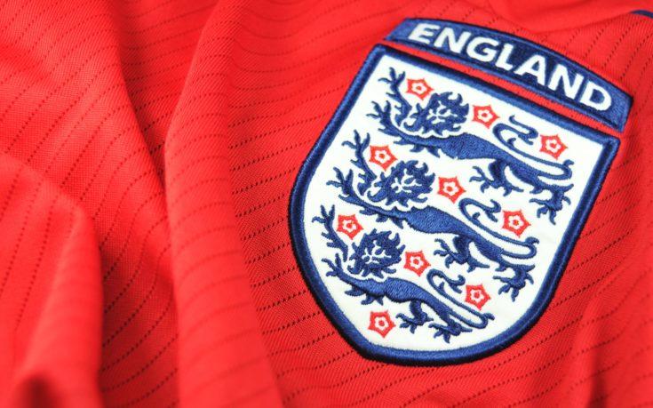 England logo embroidered onred cloth.