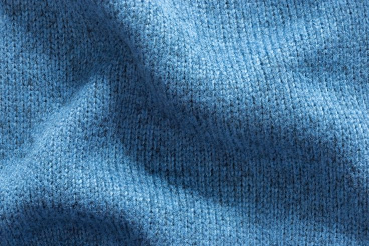 Texture background of blue polyester fabric sweater