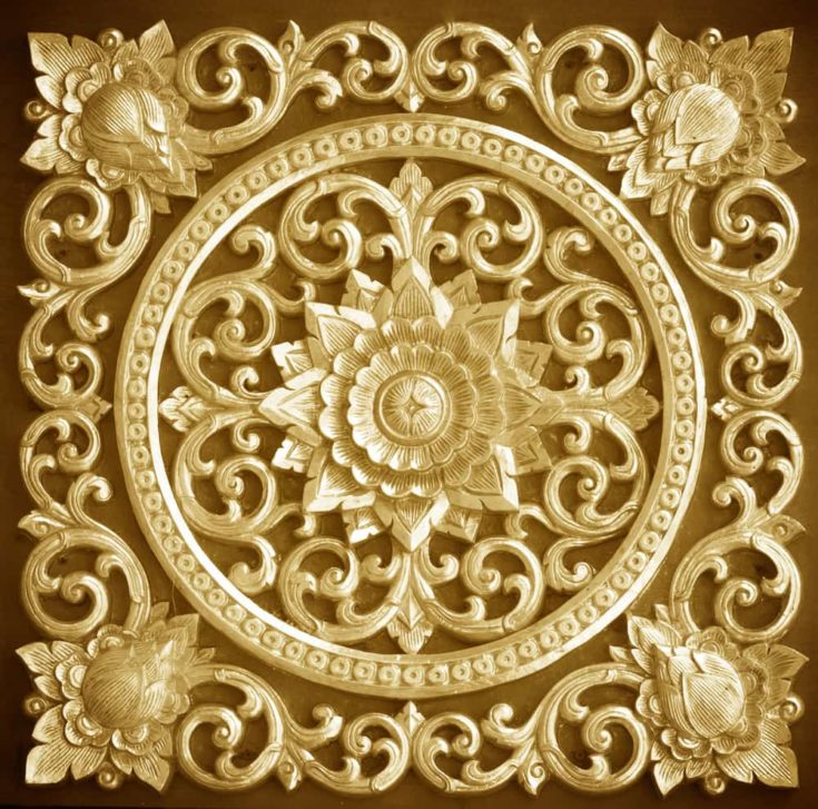 Wood carving background decorated with floral designs Thailand.