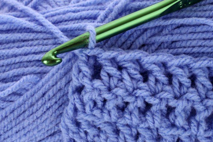 Treble crochet stitch purple with green hook