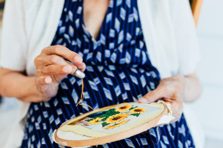 Closeup of old woman sew