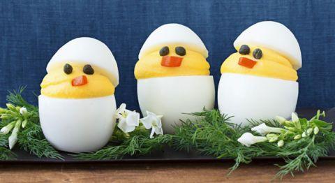 Three hardboilded egg sliced and arranged like a chick.