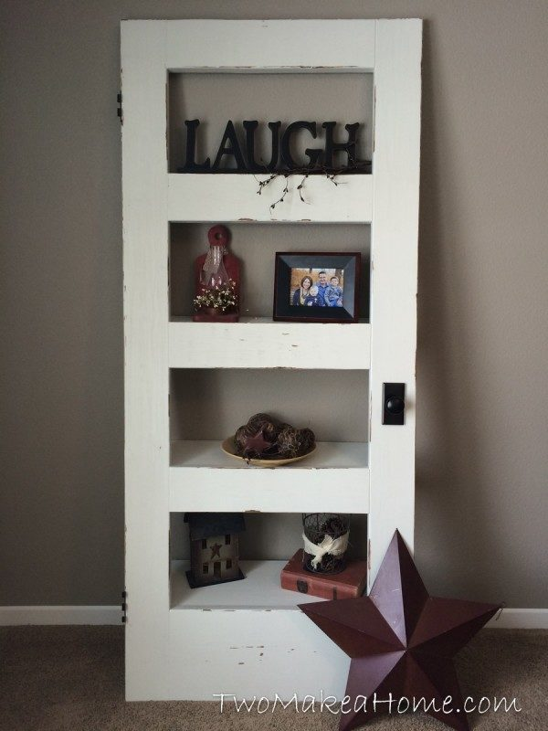 Two Make A Home Old Door Made As Shelves With Word Laugh On The Top Shelf