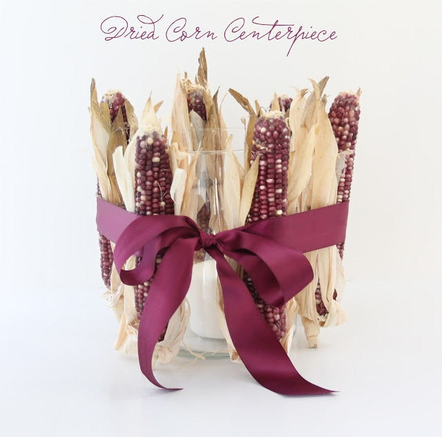 Dried corn galore centerpiece with maroon ribbon