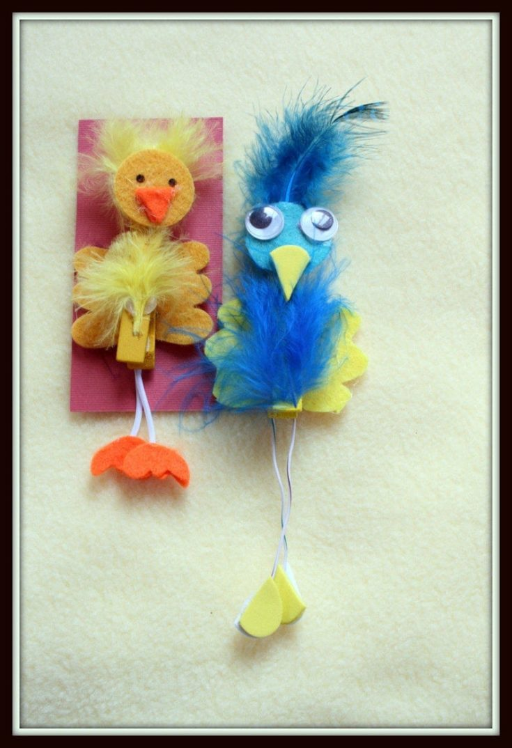 Feathered birds clip and magnets on yellow felt paper.