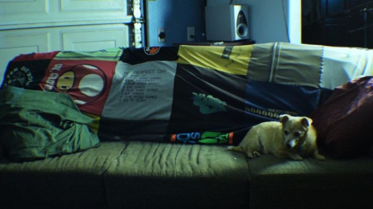 Finished blanket with a plethora of shirts and a dog