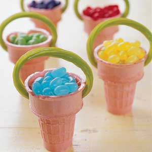 Suga ice cream cones filled with jelly beans and green licorice sticks for a handle.