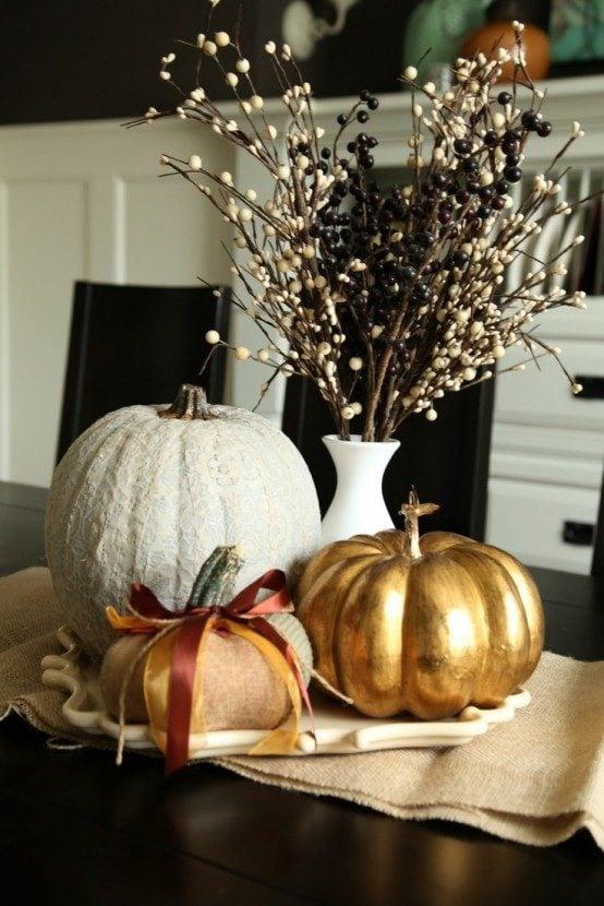 Elegant black, white and gold pumpkin centerpieces