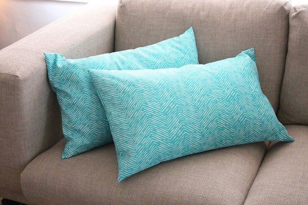 two envelope pillow cover on the sofa