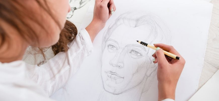 Woman drawing on paper