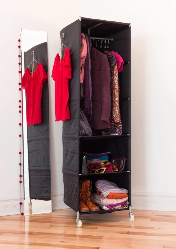 Mobile clothes organizer with red and purple clothing and accessories.