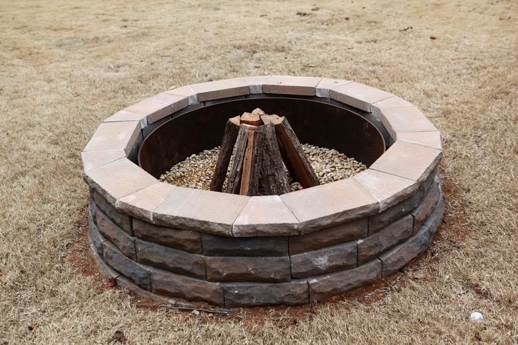 Stone Fire Pit with Metal Circle Inside