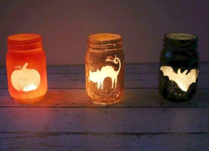 Jar luminaries deisgn with sprayed paints and a sticker for the designs.