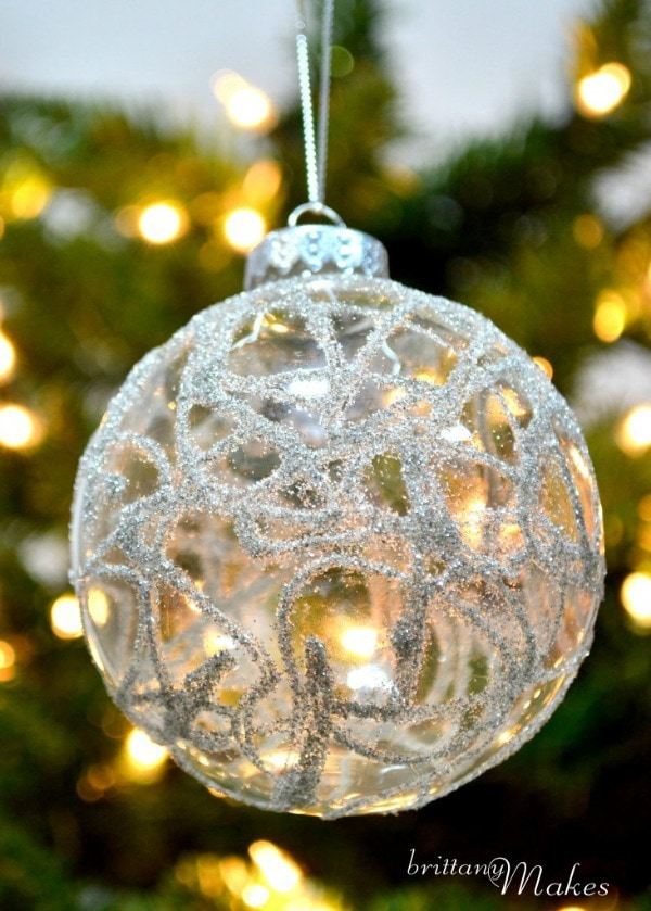 Glittered Christmas Ball Hanging on a tree Brittany Makes is Written