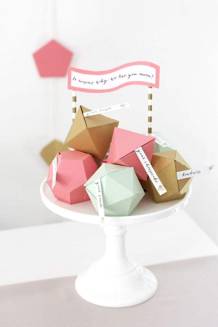 DIY geometric boxes paper crafts with tag messages on a cake stand.