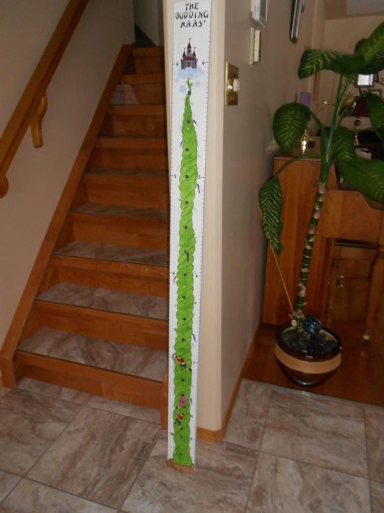 Growth chart standing beside a stair