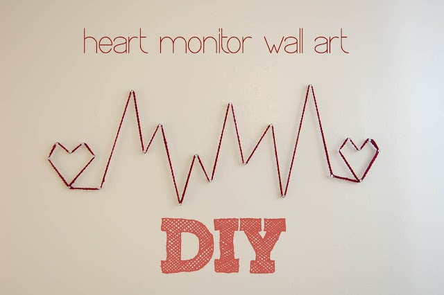 Heart monitor string art on wall.