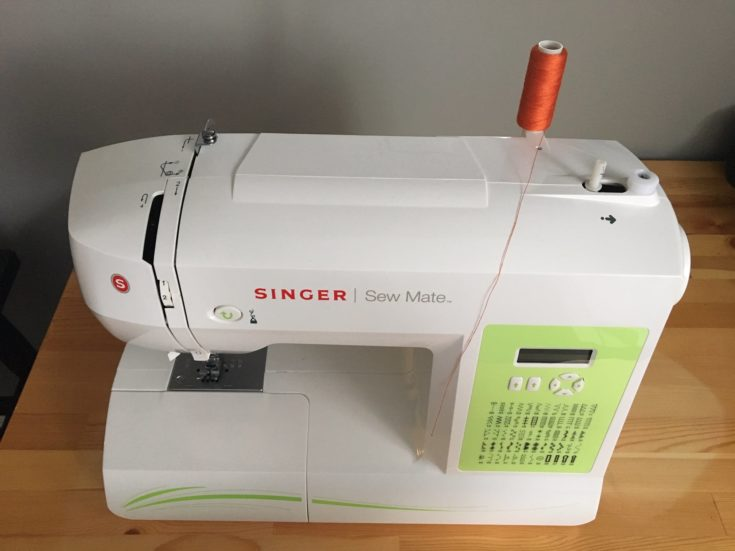 White Singer Sew Mate on the top of the table