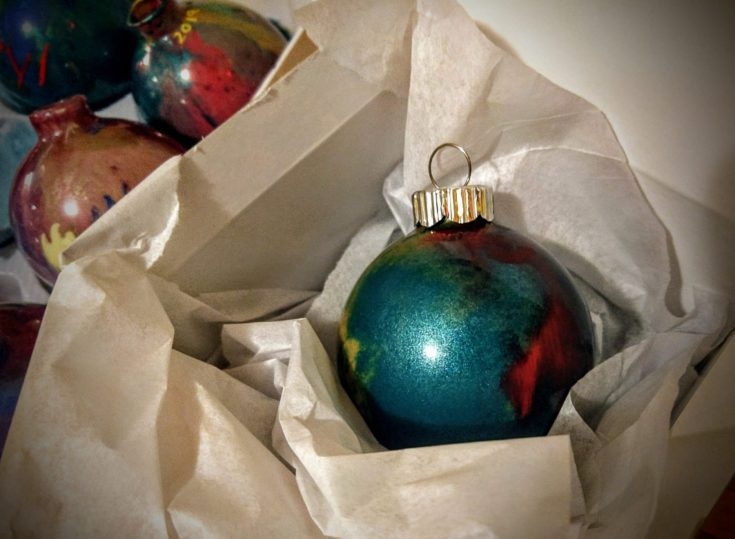 Close up shot of glass christmas ball securely place in a box.