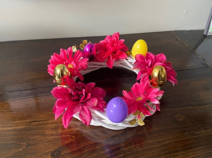 Easter twig wreath in a wooden table.