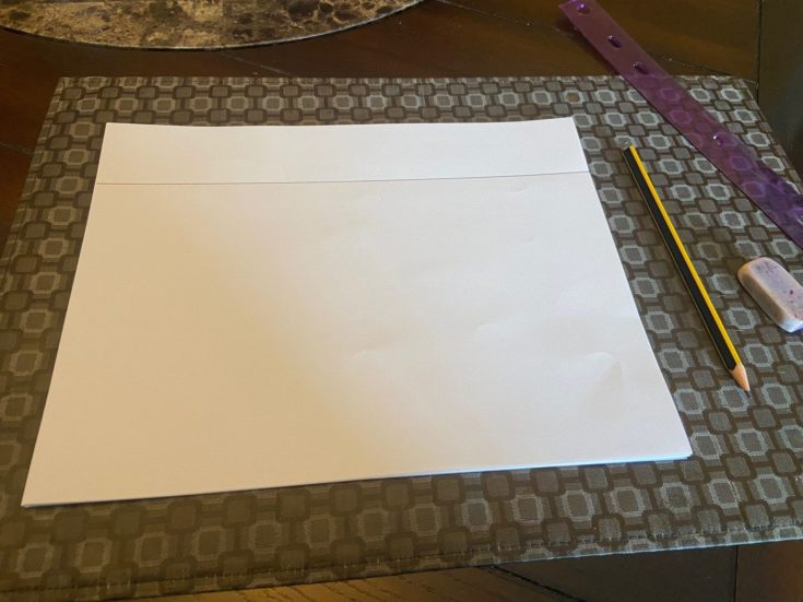 Horizontal line drawn on white paper using pencil and ruler.