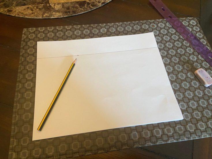 A small dot drawn on the horizon line.
