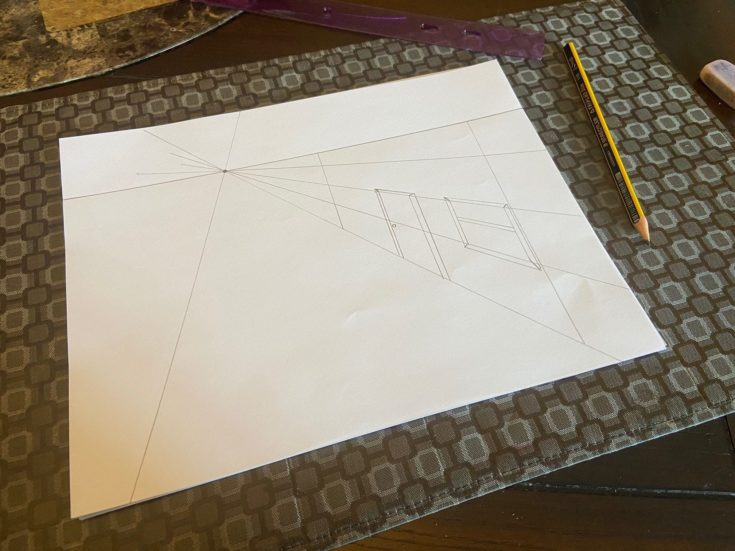 Showing a simple door and window on the side of a house using the line perspective on a paper.