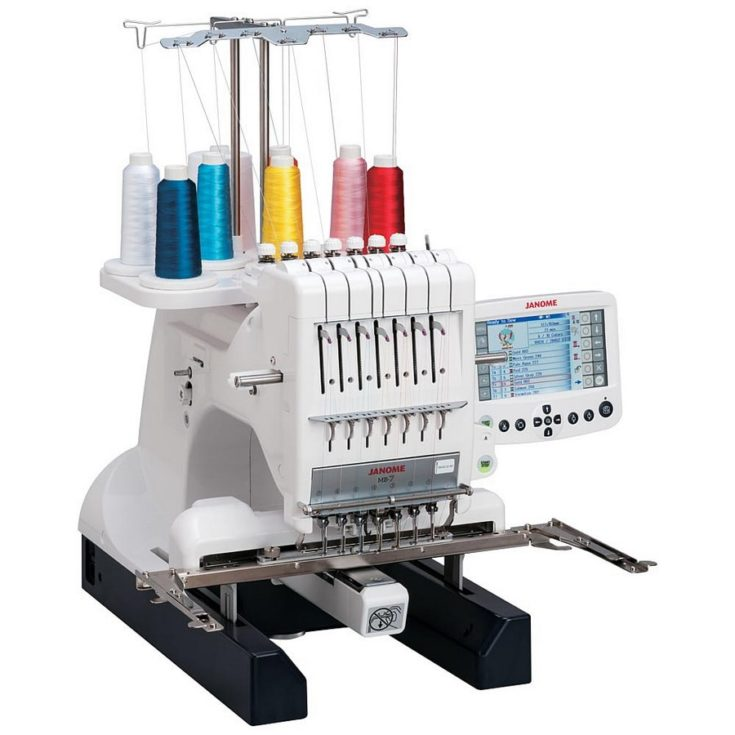 Janome MB-7 Seven-Needle Embroidery Machine in white background.