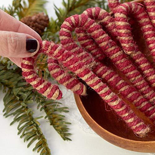 Brown and red jute candy cane inside a wooden bowl