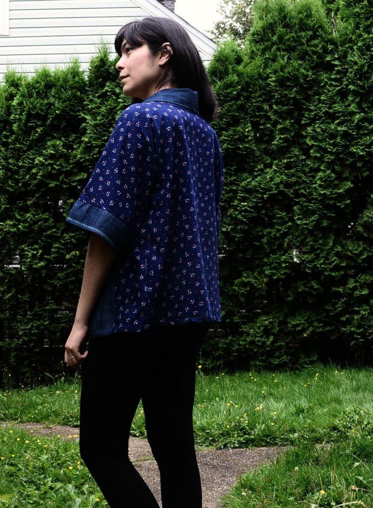 a woman wearing a blue Kimono Top with black pants