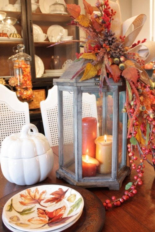 White pumpkin and candle light table centerpiece
