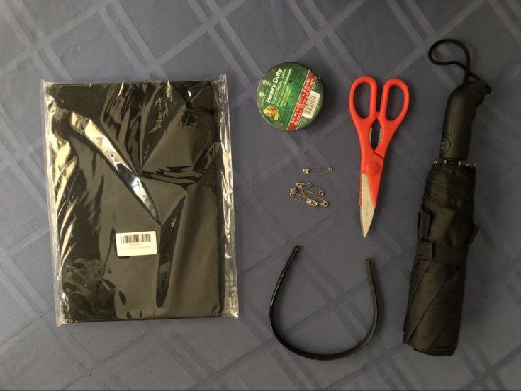 Materials for making the bat costume including headband, scissors, umbrella, pins