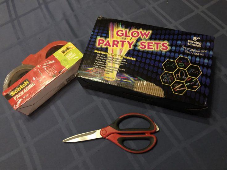 Materials for Glowing Stickman including scissors, glowing sticks, scotch tape