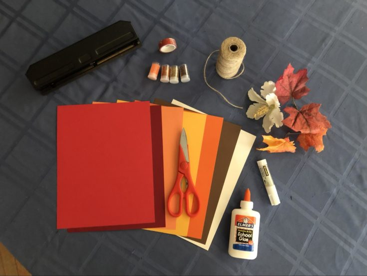 Materials needed for Bird Mask including colored papers, scissors, glue, silver dust and many more