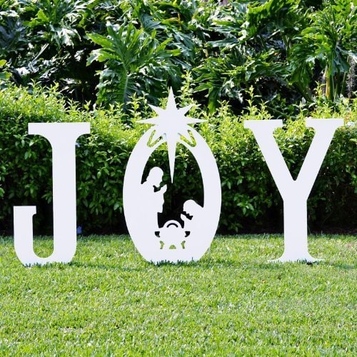 JOY white cut out letters standing on the yard