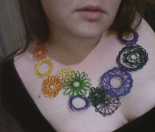 Neck Art using string of different colors.