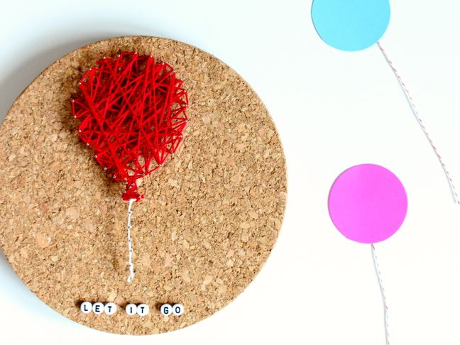 Kid friendly string art project - balloon on round cork board.