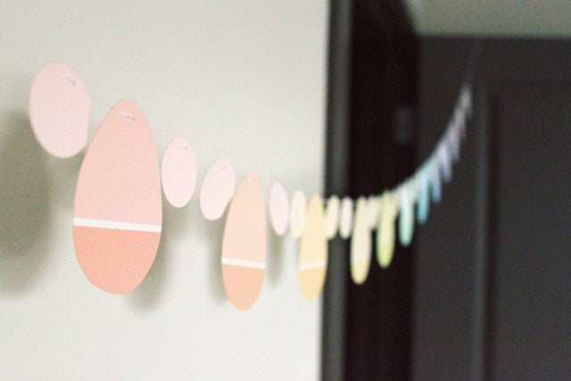 Paint chip easter egg party garland hanging on a wall.