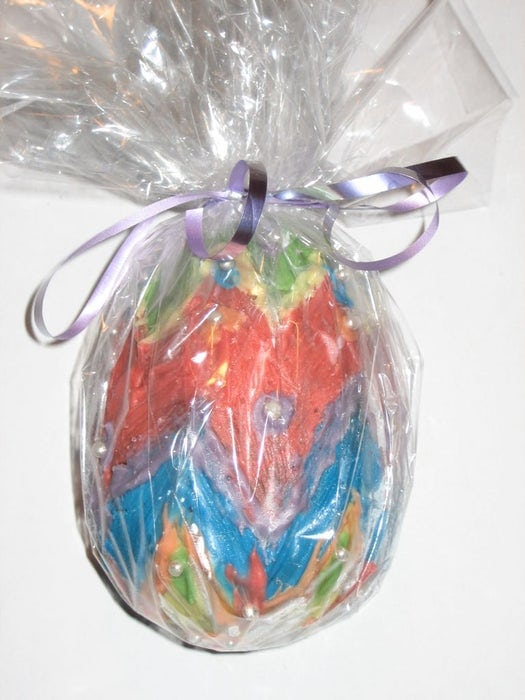 Painted egg and packed with a clear cellophane.
