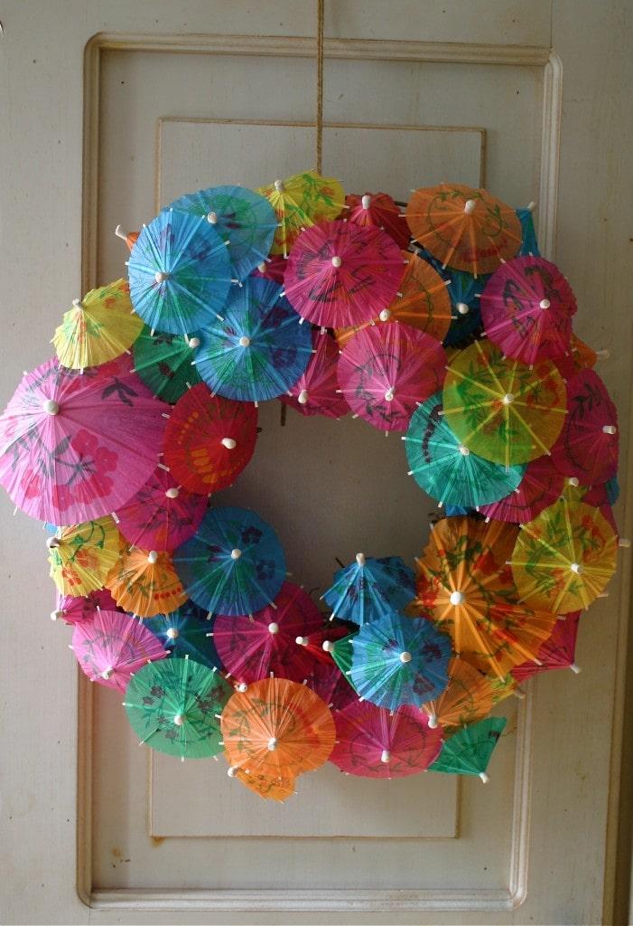 Paper Umbrella Wreath hanged on a wooden door
