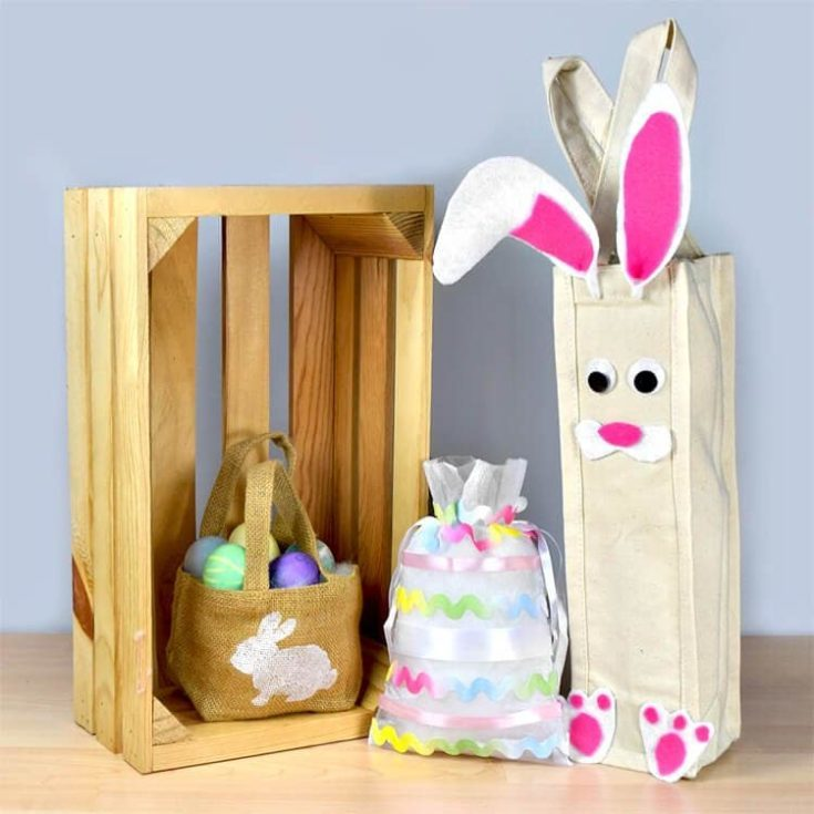 DIY goody bags with easter eggs inside displayed with the brown bag inside a wodden crate.