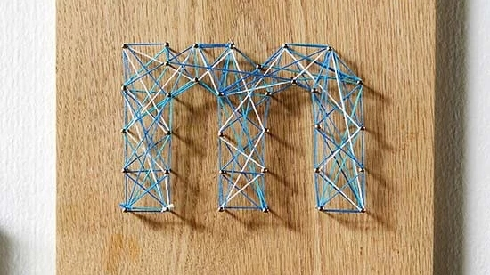 "Personalize ""M"" string art design."