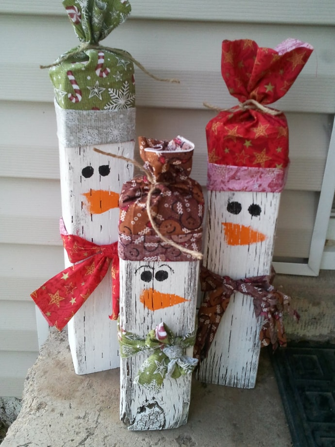 Three picket fence snowmen