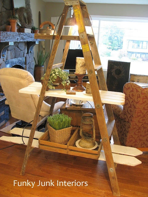 Funky Junk Interiors picket fence as shelves for an A frame ladder