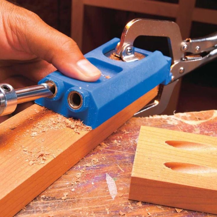 Making screw hole to the wood using a drill bit.