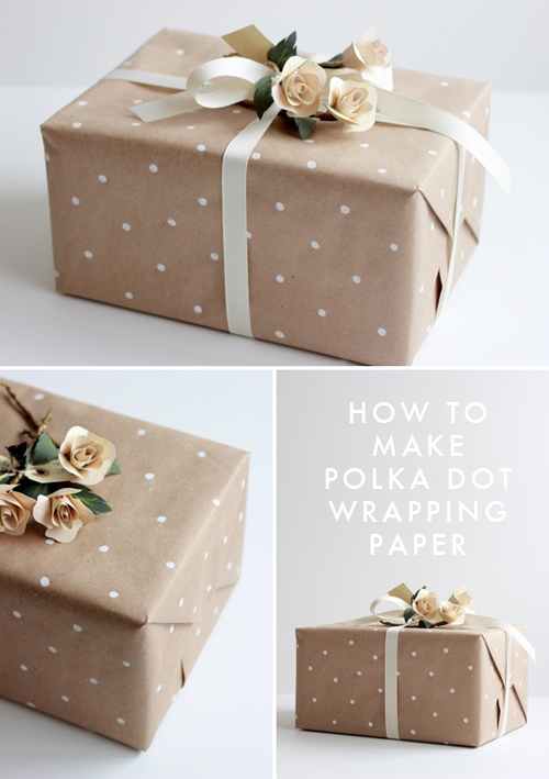 Brown wrapping paper designed with white polka dots with white ribbon and roses