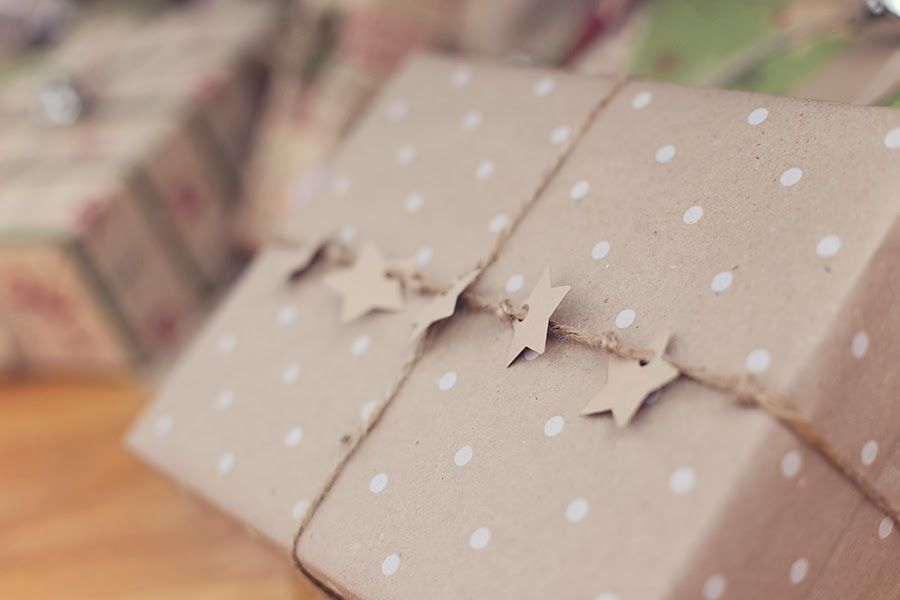 Brown wrapping paper with white polka dots with stars on a jute